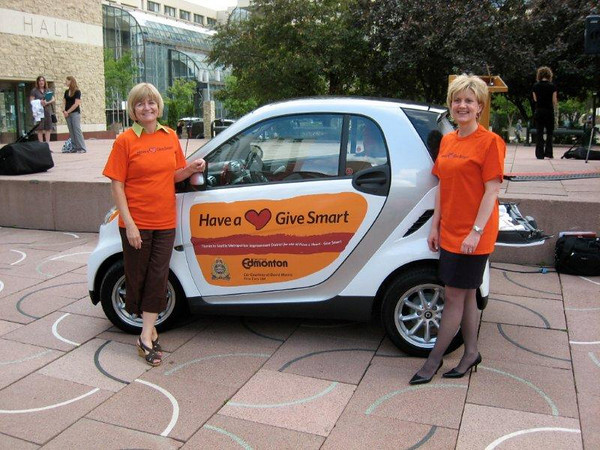 Community Services Kathy Barnhart and David Morris car rep  with Smart Car
