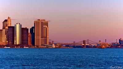New York City Skyline At Sunset From Liberty Island