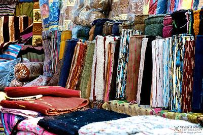 Vendors selling colorful garments & bags