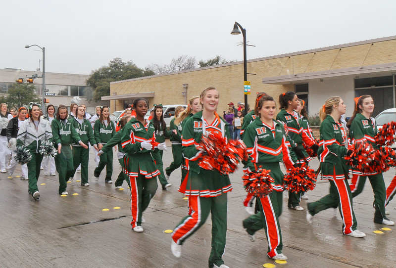 Naaman Forest Cheerleaders marching in Garland's annual NAACP MLK parade.