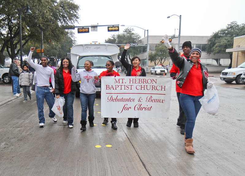 Mt. Hebron Baptist Church Debutantes and Beaux for Christ  marching in Garland's annual NAACP MLK parade.
