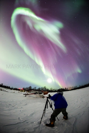 Capturing the Aurora      Friend and co-worker Scott Benedict framing up his next shot of the awesome display of Northern Lights.  Canon 5D MK III Canon EF 15mm f/2.8 Fisheye Anchorage, Alaska