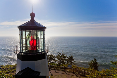 Cape Meares Lighthouse, Pacific Ocean, Oregon U.S.A. The lighthouse was built in 1889, began operation January 1, 1890 and celebrates 120 years in 2010.  The tower stands 38 feet high and is the shortest lighthouse in Oregon.  It is constructed of bricks (made right on site at a cost of $2,900) with iron plates covering it.