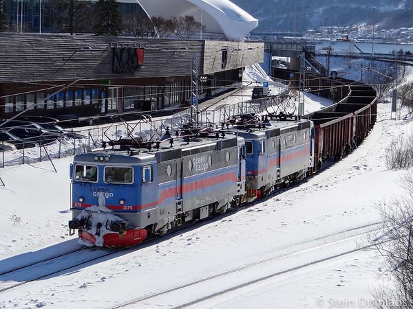 Northland Resources' Green Cargo Rc4 1175 + 1180 pulls empty Eanos set through Narvik town centre bound for mines in Sweden, 2013-04-05 16:38. Photo by Stein Doelplads.