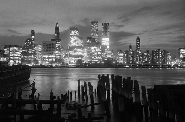"""14 Apr 1973, Manhattan, New York City, New York State, USA --- Original caption: NEW YORK: In sharp contrast to the decay of the Brooklyn waterfront, the splendor that is """"The City"""" sparkles in the early darkness of a New York night. The East River bridges the old and the new. And the newest of the new are the titanic Twin Towers of the World Trade Center, the concrete """"kings"""" of the isle of Manhattan. The dethroned Empire State Building is not shown in this view of the city's financial and municipal district nestled in the harbor's heart. --- Image by © Bettmann/CORBIS"""