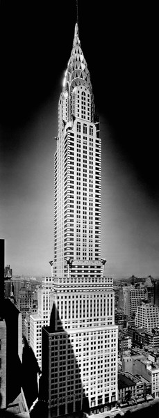 1928-1930, Manhattan, New York City, New York State, USA --- Shadows fall at the base of the 1,048 foot Chrysler Building, depicted here in 1930, the year construction was completed. New York City. --- Image by © CORBIS