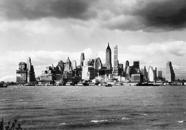 ca. 1940s, Manhattan, New York City, New York State, USA --- New York City and specifically Manhattan skyline form the harbor. --- Image by © Bettmann/CORBIS