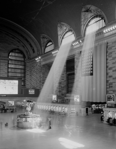 USA, New York State, New York City, interior view of Grand Central Station with rays of light coming through window --- Image by © SuperStock/Corbis