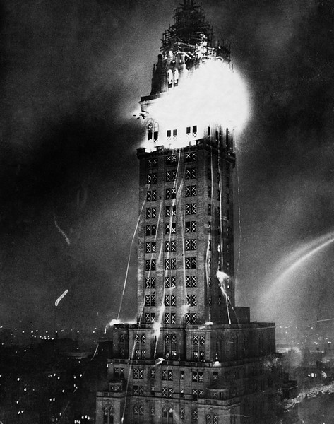 1927, Manhattan, New York City, New York State, USA --- Crowds watched a spectacular fire which raged through the scaffolding at the pinnacle of the 38-story Sherry-Netherland Apartment Hotel at Fifth Avenue and 59th Street in Manhattan. Firemen were unable to direct water at the fire and had to dodge blazing timbers that broke loose from the side of the building. --- Image by © Hulton-Deutsch Collection/CORBIS