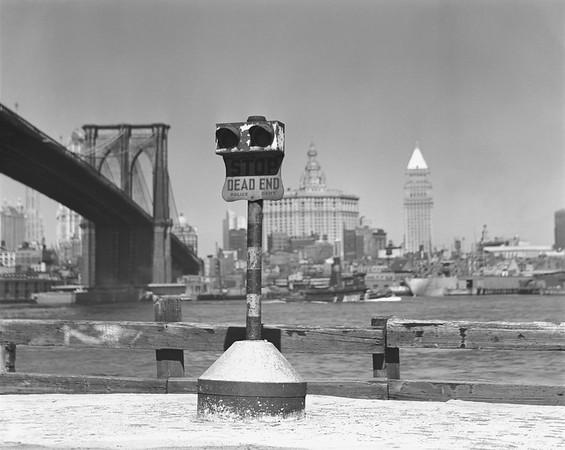 Coin-operated binoculars, Brooklyn Bridge and Manhattan skyline in background, New York City, USA --- Image by © 169/George Marks/Ocean/Corbis