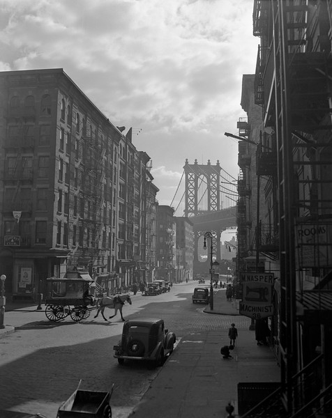 New York-ORIGINAL CAPTION READS-Pitt Street, on the east side, looking east from Canal Street, Manhattan Bridge in the background --- Image by © Underwood & Underwood/Corbis