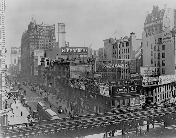 ca. 1910, Manhattan, New York City, New York State, USA --- Advertising signs and billboards cover the top of buildings on the corner of 34th Street and 6th Avenue next to the elevated train tracks. ca. 1910, New York City. --- Image by © CORBIS