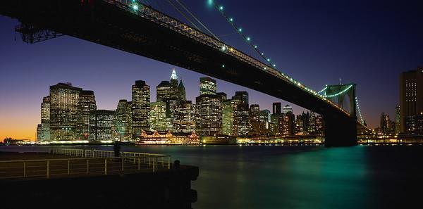 1869-1883 --- Manhattan and the Brooklyn Bridge at Night --- Image by © Jon Hicks/CORBIS