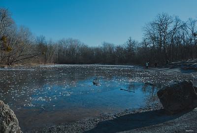 Postcard heaven, partly frozen pond,