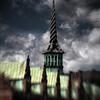 Børsen = The Stock Exchange.<br /> The tower is made of 3 intertwining dragon tails.<br /> Set fra Børskajen, København, Danmark.<br /> Fotograferet med en Lensbaby.