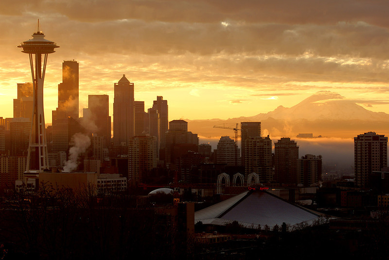 Late fall sunrise over Seattle. I loved the sun wash over part of the city and on top of the fog layer right up Mt. Rainier.