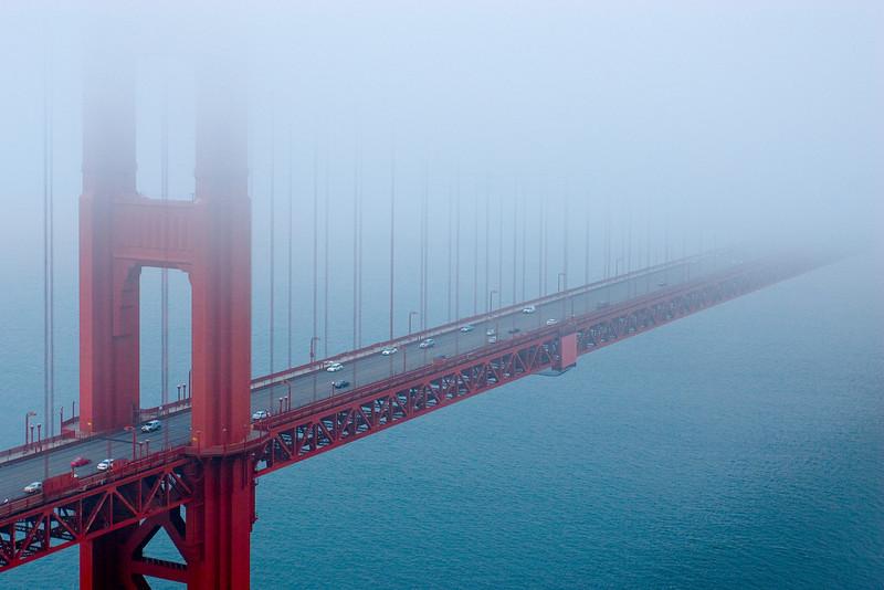 Golden Gate Bridge disappearing into the fog - San Francisco, California