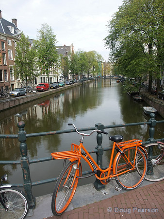 Bicycles and canals, two common modes of transportation around central Amsterdam