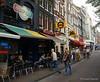 Tourists and locals enjoy Amsterdam eateries like Rick's Cafe
