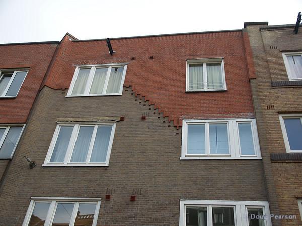 Fancy brickwork adorns one of Amsterdam's many buildings