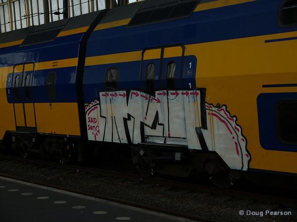 """Sad Song"" graffiti art on Dutch train rolling through Amsterdam's Centraal Station"