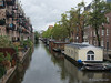 Apartments, townhouses and houseboats line the canals in Amsterdam
