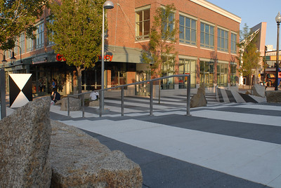 Porter Square in Cambridge.  Probably the WORST design I've ever seen in walkways.  It seems as though the ulterior motive behind it is to discourage loitering and keep pedestrians moving along quickly.