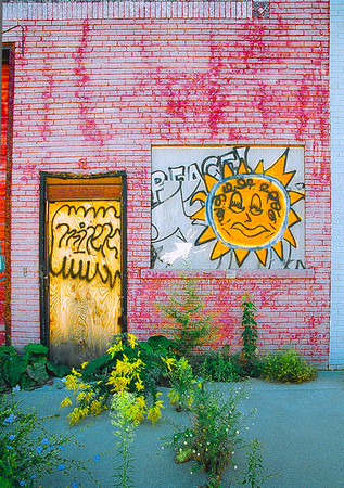 """A Little Peace,"" Rivertown District, Detroit, 2003.  This was the facade of part of a boarded up building in Rivertown Detroit that used to house a specialty sprockets business."
