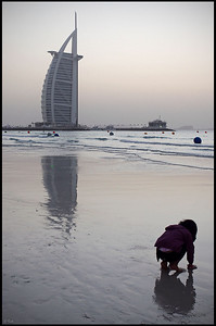 Burj Al Arab and Little Girl on the Beach, Sunset, viewed from Jumeirah Beach