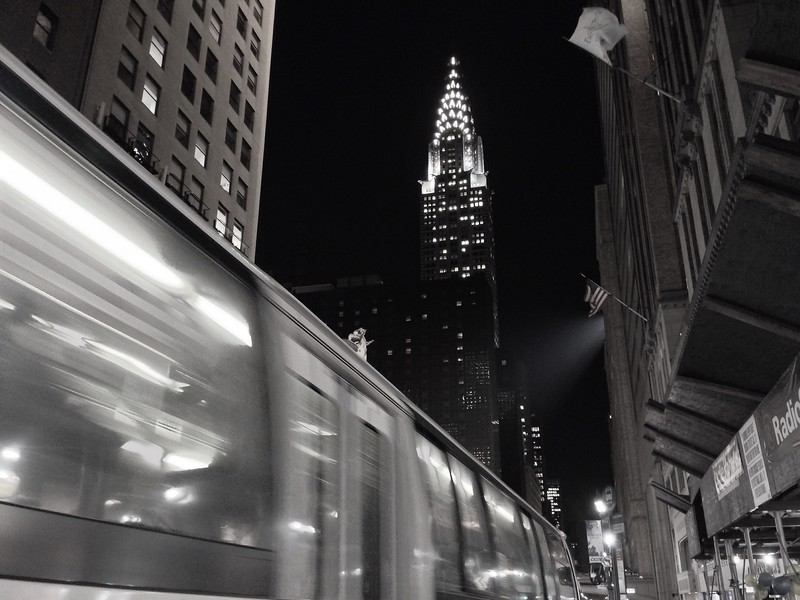 Bus Zipping By Towards the Chrysler Building - Black and White