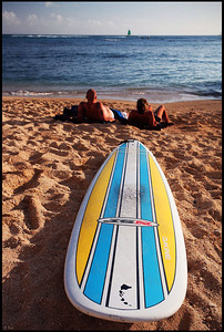 Surfboard and Surfers on Waikiki Beach, Oahu, Hawaii