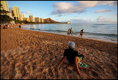 Surfer Relaxing on Waikiki Beach, Sunset, Oahu, Hawaii