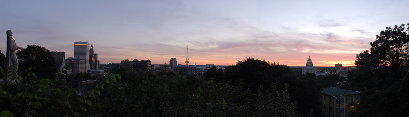 My second runthrough at a panoramic Providence skyline.<br /> <br /> The EXIF data didn't carry over, so I list it below:<br /> <br /> 8418 x 2408 Pixels (20.27 MPixels)<br /> <br /> Taken on 8/13/2006 at 7:51PM<br /> Nikon D200<br /> Lens: Nikkor 20mm f/2.8.  <br /> Exposure: f/14, 1/6 sec., ISO 320, center-weighted metering.  Exposure locked at this setting as camera was panned.<br /> Assembled from 3 images.
