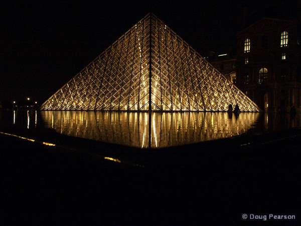 Louvre Museum entrance at night