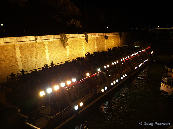 tour boat on the Seine river at night