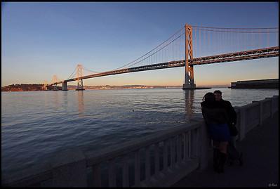 Bay Bridge and Couple, Sunset, San Francisco