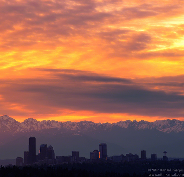 Seattle Skyline silhouette and Olympic Mountains at Sunset