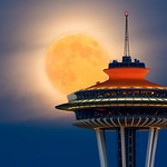 "~Moon Kissing Space Needle~    -  <a href=""http://www.nitinkansal.com"">http://www.nitinkansal.com</a><br /> <br /> This is one of those image which i wanted to shoot from a long time. This full moon was perfect opportunity for me with clear skies and clear vantage point.<br /> <br /> And this is not Photoshop composite image where you add moon from some other place and space needle from some other place.<br /> <br /> Please click on link to help me increase my site ranking: <a href=""http://tiny.cc/kvomiw"">http://tiny.cc/kvomiw</a><br /> <br /> I hope you will like it."