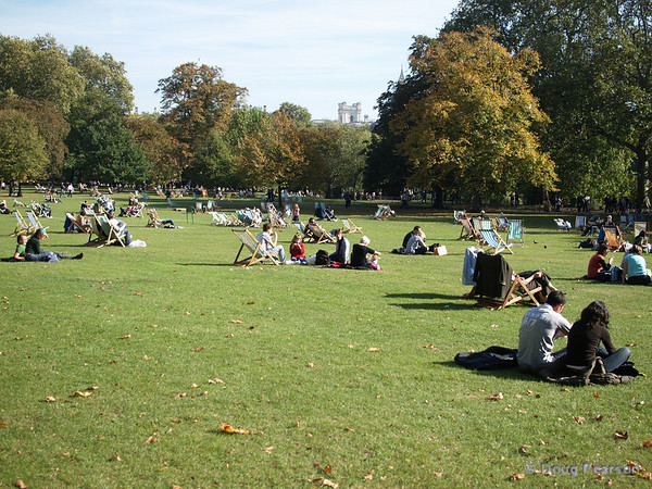 People enjoying the sun, St James Park, London, UK