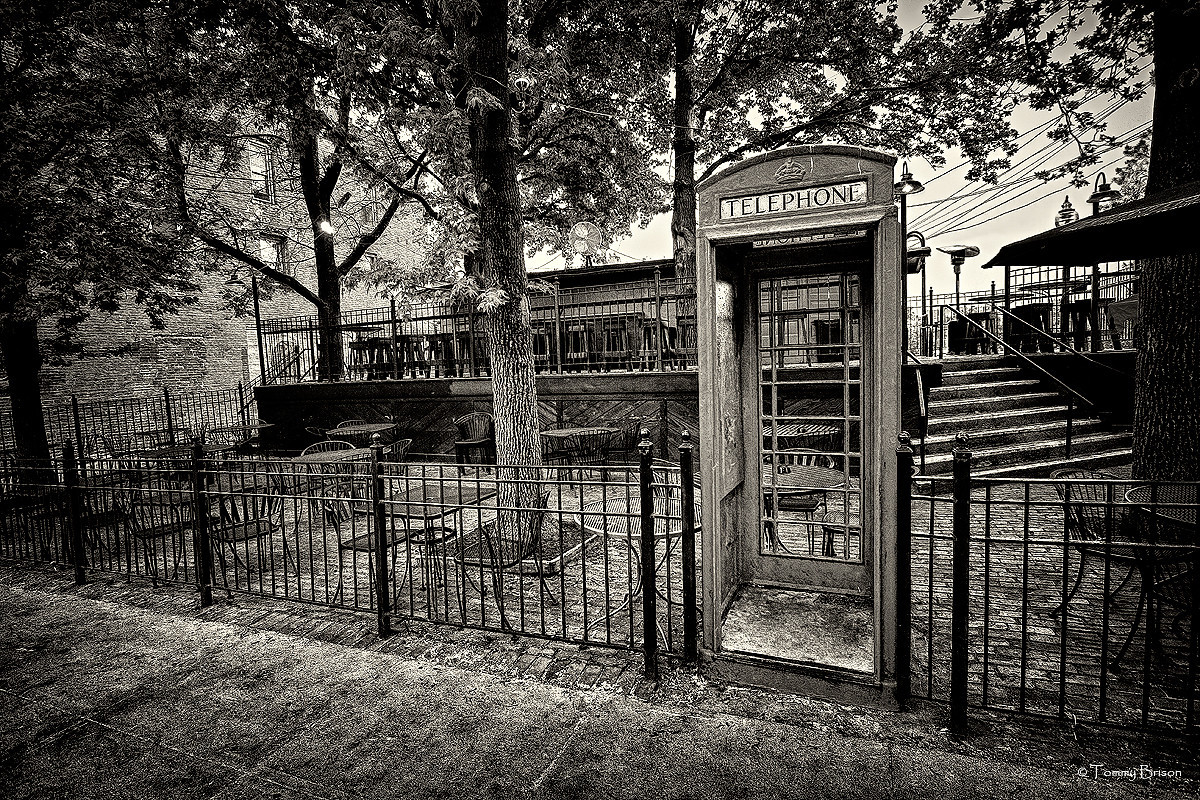 A view of an old telephone booth in the Westport District of Kansas City, Missouri.  Shot on April 4th, 2012.  © Tommy Brison