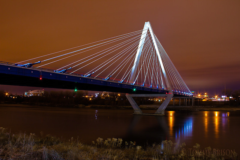 December 18th, 2011<br /> I called another photographer friend of mine and asked if he would like to go out shooting some with me.  We went to vaious places around Kansas City area to capture some cityscape images. The new Christopher S. Bond Missouri River Bridge is a dual-span cable-stayed bridge, anchored by a 260-foot (79 m) tall delta-shaped pylon. The pylon rises 316 feet (96 m) above the Missouri River.