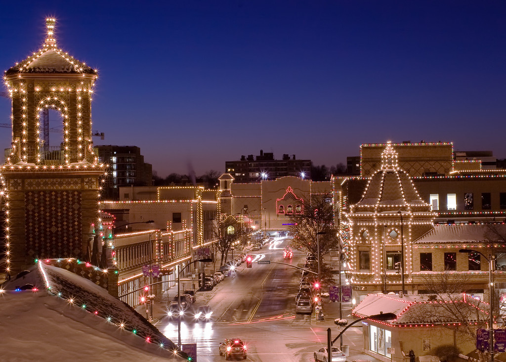 A view of the Kansas City Country Club Plaza Christmas lights and the skyline of downtown Kansas City.
