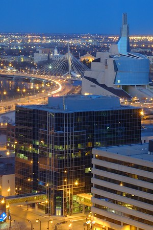 Winnipeg's skyline from the 25th floor of the Radisson hotel on Portage. In the center of the background one can see the Louis-Riel Esplanade Bridge, on its right the St. Boniface Cathedral, and on its left the dome of the Collège Universitaire de St-Boniface.