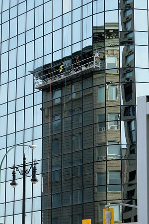 Window washing near Portage St., downtown Winnipeg. Which building are these men washing?