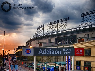 Sun going down on Wrigley from the Addison L stop