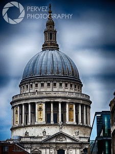 View of St. Paul's Cathedral from the Millennium Bridge on a cloudy day in London