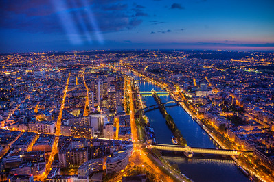 Paris, the City of Light with the rotating beacon atop the Eiffel.