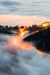 Foggy road winding through Malibu