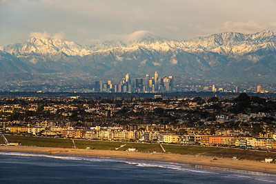 Los Angeles with snow covered mountains and beach views
