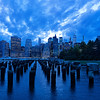 A long, great story behind this (and the next) photo. A few friends and I decided to shoot the Brooklyn area around sunset, which explains the blue color (somewhat long exposure on a night when the sun and sky played very nicely together - this is with really no touch-up in editing, either). We started in the park (previous photos), then made our way to the bowies and the view of Manhattan. This photo was taken a little before sunset. The area was filled with photographers who had set up their tripods and cameras. Everyone was just chatting, exchanging stories, tips, and inviting each other to shoot together. It was a very mixed group (age, race, gender), and that was really peaceful to watch. While waiting for shots, there was a older Indian couple that came up. They were in their early 50s, and asked me to take a shot of them. I was happy to oblige. As I was ready to shoot, the man grabbed his wife's chest unexpectedly. She slapped him, then they both started cracking up. So did everyone around. It was hilarious and loving at the same time. We chatted for a minute, and then they went on their way, hand in hand. Finally, there was a Pakistani family (with two young daughters) who walked by. A 30-something African American man also came by with his dog. The two girls were mesmerized by the dog (I'm not a dog person, all I can tell you is the dog was small), but scared to approach. The young man told them it was fine and they should just pet him. Another young child jumped the queue and started playing with the dog. The man loved it, and took a few photos. The kid and the dog were also having fun. He then kept telling the girls the dog was friendly. Their mother came by and told them not to get close. The young man smiled and reassured the mother it was fine. Before she could reply, the youngest daughter, no more than 2, decided to just go for it. She hugged the dog and had the biggest smile on her face. The older daughter also went for it. The mother shook her head and started laughing with the dog owner. After a few minutes of playing, the girls came by me. Their parents told them to leave me alone, but I told them to come closer. I showed them the view on my LCD screen and showed them what I was going to do. They were smiling....though maybe that was the after-effect of playing with the dog. Finally, the family asked me if I wouldn't mind taking a photo of them. I did, we chatted for a few minutes, and they went on their way. It was an evening of such tranquility, and somewhere in that process I snapped a handful of photos of this view. The pictures were great, but particularly because they reflected the peacefulness of the atmosphere in which they were shot. The scene around it made the scene itself - just a lot of beautiful harmony amongst all the people there. I'm not alone in this - everyone shooting spent maybe a quarter of their time focusing on their shots, and the rest interacting with everything happening around us. Its the best part of photography - storytelling through pictures, even when the stories are reflecting in, but not part of, the photos.